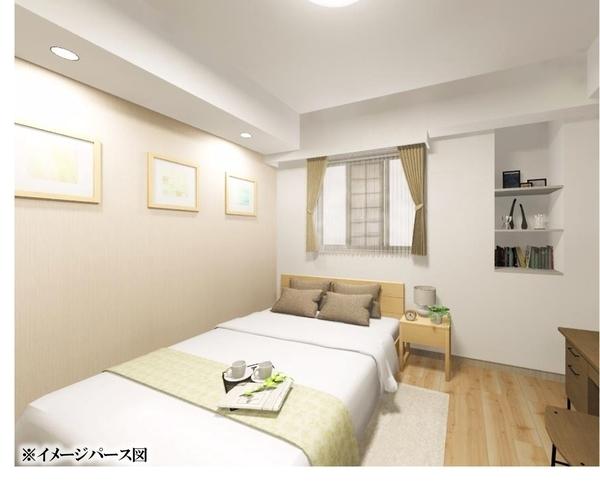主寝室にふさわしい約6.2帖の洋室一部壁には、空間に馴染みやすい淡い色のアクセントクロスを採用。